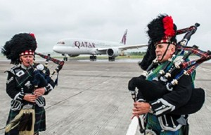Qatar Airways'  flight to Edinburgh was met with a traditional  Scottish bagpipes