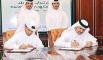 Ibrahim J al Othman, GDI CEO and  Engineer Abdullah Fadhalah al Sulaiti, N-KOM Chairman