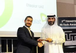 Hassan Hussain, Vice president of Customer Experience, Etisalat receiving the award