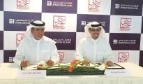 HE Hamad Buamim and Jamal Bin Ghalaita signing the MOU