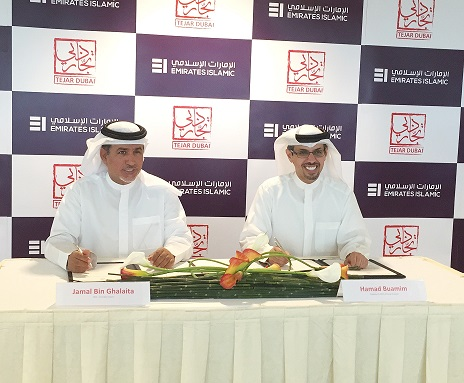 HE Hamad Buamim and Jamal Bin Ghalaita signing the MOU
