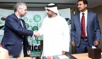 L-R: Luis Rein, Grupo Cobra shakes hands with Rashid Mehran Al Baloushi, Utico.