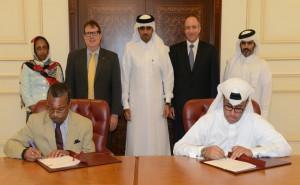 Stephen Blount , Director of Special Health Projects, Carter Center sing the agreement with  Ali Abdullah Al Dabbagh, Executive Director, QDF